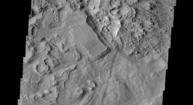 This image from NASA's Mars Odyssey shows a region on the north end of Gordii Dorsum. Wind is the main source of erosion in this region, so the unusual texture may indicate that the surface material in this region is different from nearby regions.