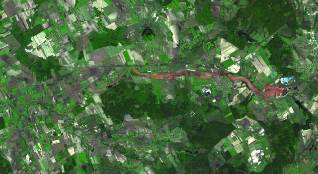 The ASTER instrument onboard Terra's spacecraft imaged the toxic sludge spill in Hungary on Oct. 11, 2010. A million cubic meters (35 million cubic feet) of red sludge spilled from a reservoir at an alumina plant in Ajka in western Hungary.