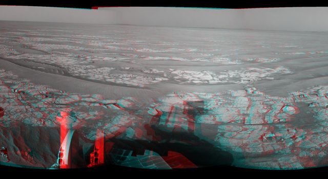 This stereo mosaic of images from NASA's Mars Exploration Rover Opportunity shows surroundings of the rover's location following an 93.3-meter (306-foot) drive east-northeastward on Oct. 6, 2010. 3D glasses are necessary to view this image.