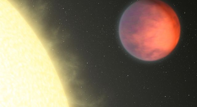 This artist's concept based on data found by NASA's Spitzer Space Telescope shows upsilon Andromedae b, a hot gas giant that whips around its star every 4.6 days. Because it is so close to its star, it is tidally locked.