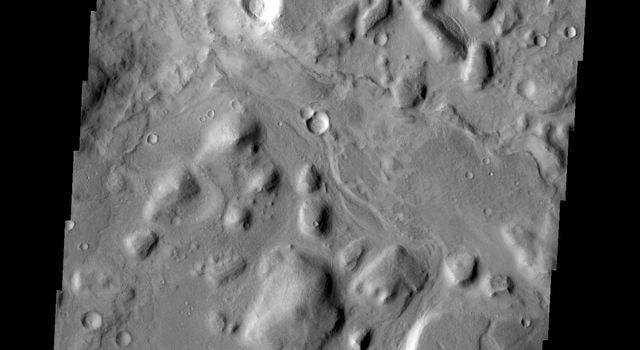 Chaos and small channels mark the boundary between the highlands of Terra Sabaea and the lowlands of Utopia Planitia in this image captured by NASA's Mars Odyssey.