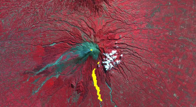 The ASTER instrument onboard NASA's Terra's spacecraft imaged the hot volcanic flow that resulted from collapse of the summit lava dome from the Merapi volcano in Indonesia that erupted on Oct. 26, 2010.