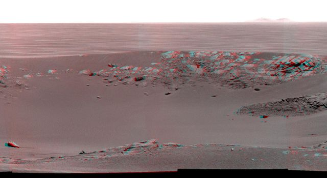 'Intrepid' crater on Mars carries the name of the lunar module of NASA's Apollo 12 mission, which landed on Earth's moon Nov. 19, 1969. NASA's Mars Exploration Rover Opportunity recorded this stereo view on Nov. 11, 2010. 3D glasses are necessary.