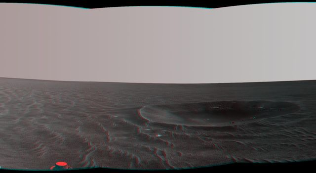 'Yankee Clipper' crater on Mars carries the name of the command and service module of NASA's 1969 Apollo 12 mission to the moon. NASA's Mars Exploration Rover Opportunity recorded this stereo view on Nov. 4, 2010. 3D glasses are necessary.