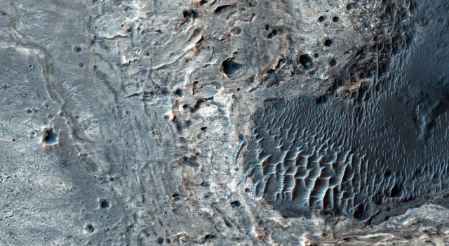 This image from NASA's Mars Reconnaissance Orbiter shows a number of unusual, quasi-circular structures that apparently formed within bright flows in Meridiani Planum.
