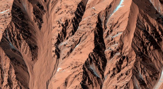 The crater shown in this image from NASA's Mars Reconnaissance Orbiter has very few craters superposed on it, which attests to its youth. It also has very steep slopes and a sharp rim; more evidence of its young age.