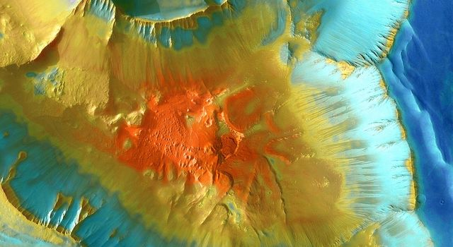 This false-color mosaic focuses on one junction in Noctis Labyrinthus where canyons meet to form a depression 4,000 meters (13,000 feet) deep. This image is from NASA's Mars Odyssey, one of an 'All Star' set.