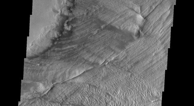 This image captured NASA's Mars Odyssey shows part of a landslide deposit in Melas Chasma.