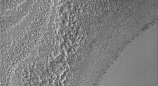 It is early springtime in the southern hemisphere of Mars in this image from NASA's Mars Odyssey. The south polar cap is now illuminated by the sun and the surface can be studied as it changes with the passage of spring.