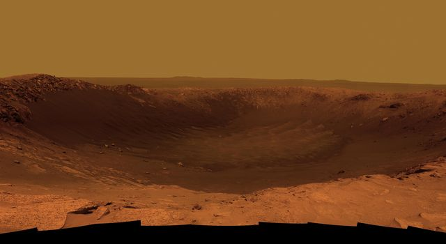 NASA's Mars Exploration Rover Opportunity is spending the seventh anniversary of its landing on Mars investigating a crater called 'Santa Maria,' which has a diameter about the length of a football field. This scene looks eastward across the crater.