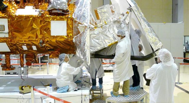Technicians from NASA's Jet Propulsion Laboratory in Pasadena, Calif., install thermal blankets on the Aquarius instrument at Brazil's National Institute for Space Research.