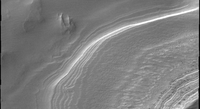 Layering in south polar ice is easy to see in this outlier of the main polar cap. This image was captured by NASA's Mars Odyssey.
