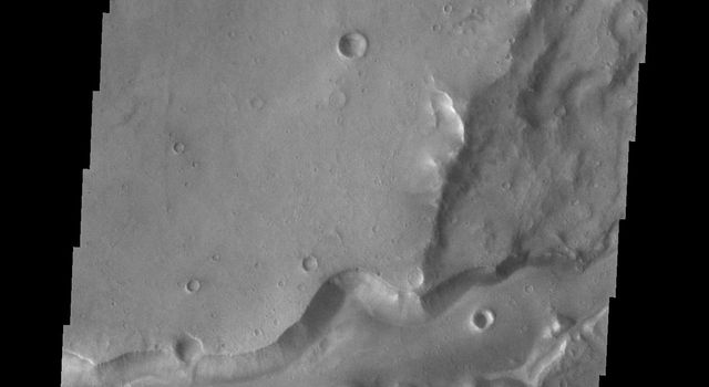 This image from NASA's Mars Odyssey shows Bahram Vallis where it enters Waspam Crater. Bahram Vallis exits the crater to the north a short distance from this location along the rim of Waspam Crater.