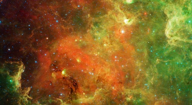 This visible light/infrared image from NASA's Spitzer Space Telescope shows a swirling landscape of stars known as the North America nebula. Clusters of young stars (about one million years old) can be found throughout the image.