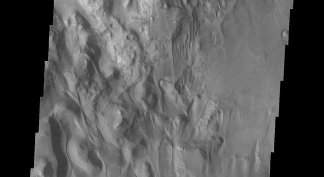 Sand is common in the region of Juventae Chasma as shown in this image from NASA's Mars Odyssey.
