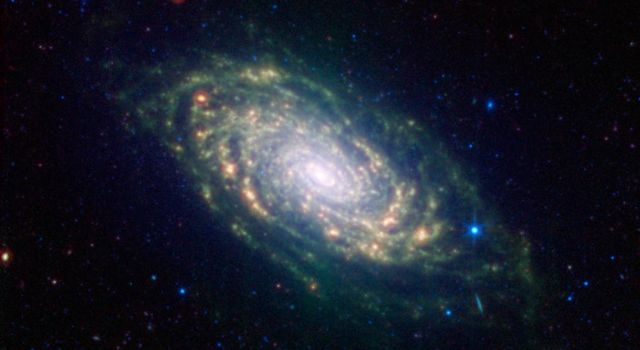 This image from NASA's Spitzer Space Telescope shows infrared light from the Sunflower galaxy, otherwise known as Messier 63. Spitzer's view highlights the galaxy's dusty spiral arms.