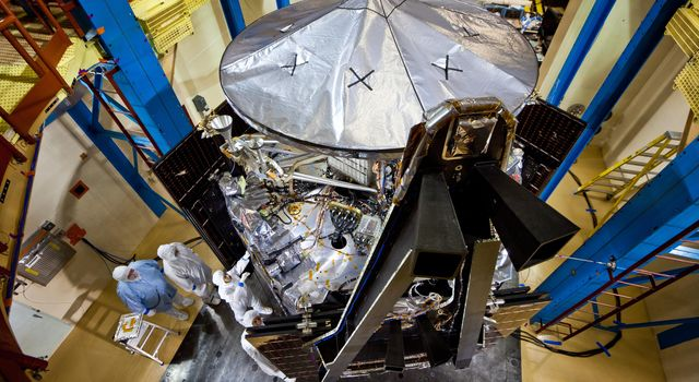 This image shows NASA's Juno spacecraft undergoing environmental testing at Lockheed Martin Space Systems on Jan. 26, 2011. All 3 solar array wings are installed and stowed, and the large high-gain antenna is in place on the top of the avionics vault.