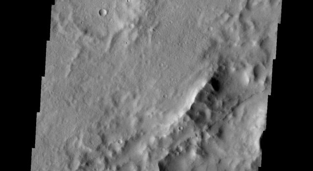 The collapse valleys in this portion of the floor of Bernard Crater were likely caused by the formation of Memnonia Fossae, a system of tectonic graben, that passes through the region. This image was captured by NASA's Mars Odyssey.
