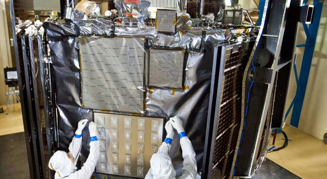 Technicians inspect NASA's Juno spacecraft and its science instruments following acoustics testing at Lockheed Martin Space Systems in Denver, Colo. on Jan. 26, 2011.