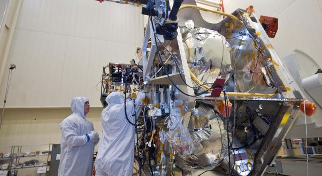 Technicians install components that will aid with guidance, navigation and control of NASA's Juno spacecraft.