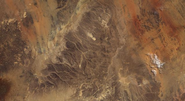 Acquired by the Multi-angle Imaging SpectroRadiometer instrument aboard NASA's Terra spacecraft, this image is from the MISR Where on Earth...? Mystery Quiz #27. Location is Jordan.