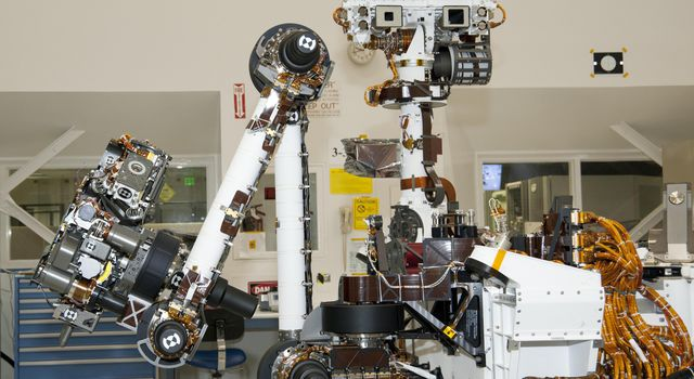 The arm and the remote sensing mast of the Mars rover Curiosity each carry science instruments and other tools for NASA's Mars Science Laboratory mission. This image shows the arm on the left and the mast just right of center.