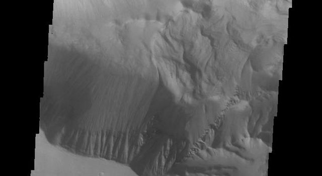 This image from NASA's Mars Odyssey shows the western end of Candor Chasma, including a large landslide deposit.
