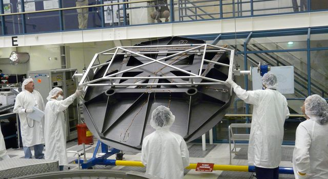 Engineers test Aquarius 2.5 meter reflector in the clean room at NASA's Jet Propulsion Laboratory in Pasadena, Calif.