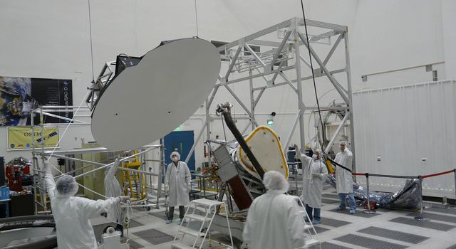 Aquarius 2.5 meter reflector is hoisted before being attached to boom in the clean room at NASA's Jet Propulsion Laboratory in Pasadena, Calif.
