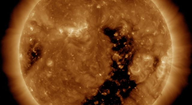 NASA's Solar Dynamics Observatory captured an elongated coronal hole rotated across the face of the sun this past week so that it is now streaming solar wind towards Earth (Jan. 2-5, 2017).