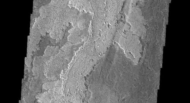 This image captured by NASA's 2001 Mars Odyssey shows just one of the many lava flows that make up Daedalia Planum. Theses volcanic flows are from Arsia Mons, the southernmost of the three Tharsis Montes.