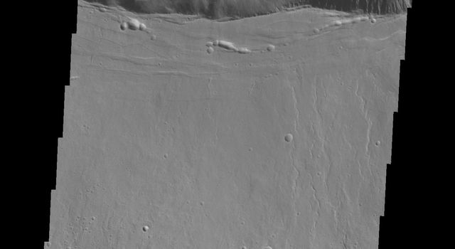 This image captured by NASA's 2001 Mars Odyssey shows the southern summit caldera of Ascraeus Mons.