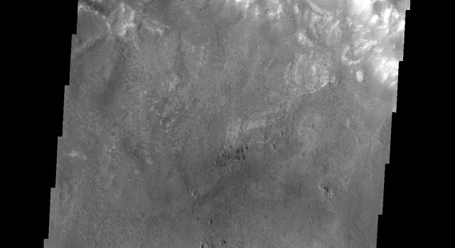 As wind is the only active geologic process on Mars today, sand and dust continue to be moved around the surface. Most craters host a sand dune or two, like this unnamed crater in Tyrrhena Terra. This image is from NASA's 2001 Mars Odyssey.