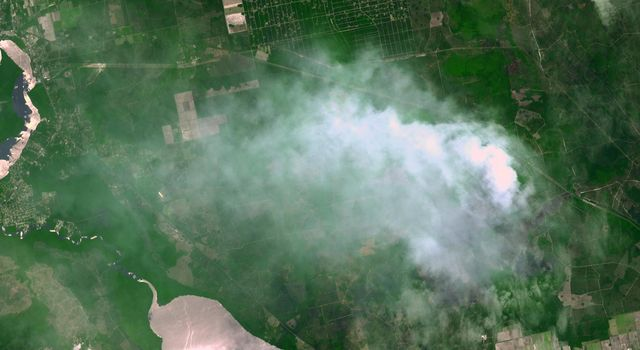The Espanola wildfire had consumed more than 4,300 acres when the Advanced Spaceborne Thermal Emission and Reflection Radiometer (ASTER) instrument aboard NASA's Terra spacecraft acquired this image on June 16, 2011, over Flagler County, Fla.