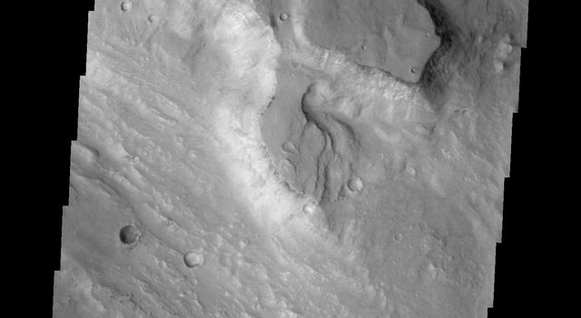 The channel at the top of this image captured by NASA's 2001 Mars Odyssey spacecraft runs between Galilaei Crater and the main channel on the northeastern side of Hydaspis Chaos.