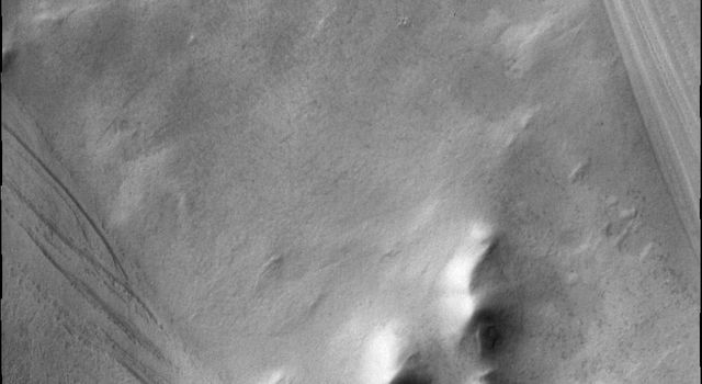 The surface beneath the south polar cap as seen by NASA's 2001 Mars Odyssey spacecraft at the highest latitude in Chasma Australe.