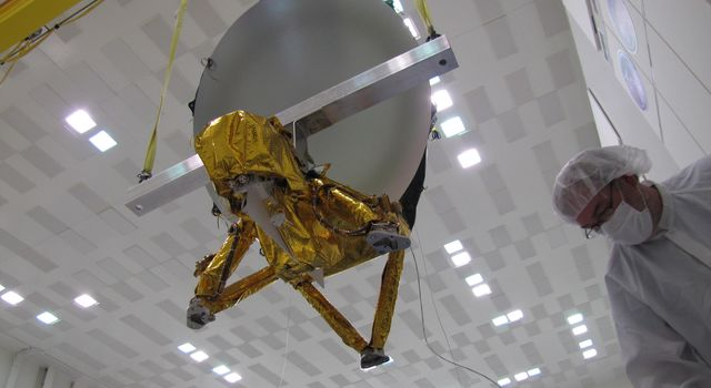 JPL technicians perform a practice run of the mechanical integration sequence that will be used to mate the Jason-3 spacecraft's Advanced Microwave Radiometer instrument to the Jason-3 satellite.