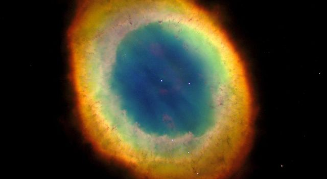 NASA's Hubble Space Telescope captured this sharpest view yet of the most famous of all planetary nebulae: the Ring Nebula (M57). The colors are approximately true colors.