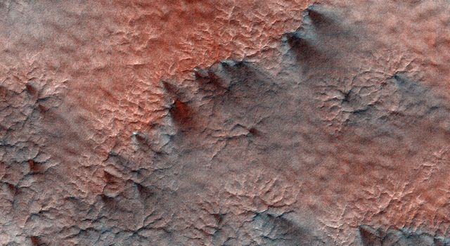 This terrain, as seen by NASA's Mars Reconnaissance Orbiter, looks like lumpy sediment on top of patterned ground. The lumpy sediment is likely just loosely consolidated because it is covered with spidery channels.