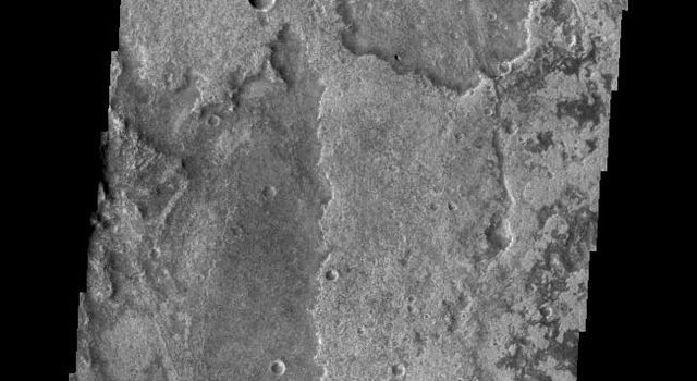 Just as on Earth, volcanism and tectonism are found together on Mars. In this image from NASA's 2001 Mars Odyssey spacecraft the ridges and fractures of Claritas Fossae are affecting or perhaps hosting the volcanic flows of Solis Planum.