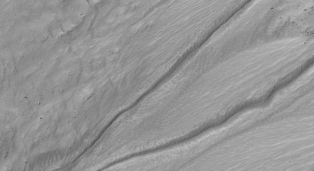 This image, taken by the HiRISE camera onboard NASA's Mars Reconnaissance Orbiter is of a gully on a south-facing slope in middle southern latitudes of Mars.