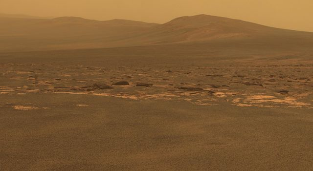 A portion of the west rim of Endeavour crater sweeps southward in this color view from NASA's Mars Exploration Rover Opportunity. The rover's first destination on the rim, called 'Spirit Point' in tribute to Opportunity's now-inactive twin, Spirit.