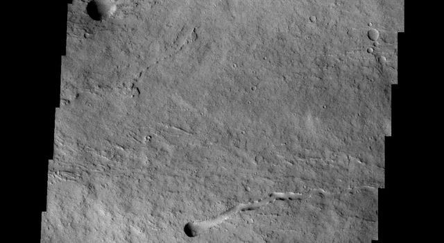 Taken by NASA's 2001 Mars Odyssey spacecraft, this image of the northeastern flank of Ascraeus Mons shows several volcanic channels.