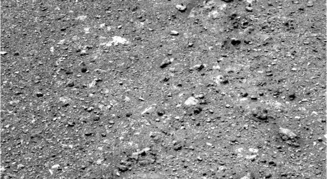 The soil at this location has a different texture than any that NASA's Mars rover Opportunity has seen earlier. The largest features on the ground in this image are a few inches or centimeters across.