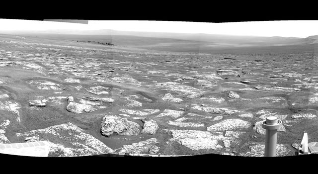 The foreground area is a portion of an area called 'Botany Bay' between two ridges forming part of the western rim of Endeavour crater. NASA's Mars Exploration Rover Opportunity recorded this mosaic view centered toward the southeast on Aug. 6, 2011.