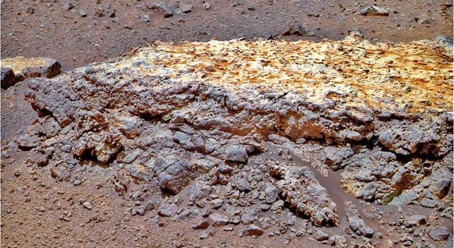 "This rock, informally named ""Tisdale 2,"" was the first rock NASA's Mars Rover Opportunity examined in detail on the rim of Endeavour crater. It has textures and composition unlike any rock the rover examined during its first 90 months on Mars."