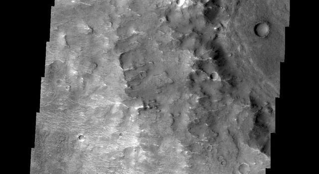 With the extensive amount of dust and sandy materials on Mars, dunes are a pervasive feature. Many dunes are small, like the ones in this image from NASA's 2001 Mars Odyssey spacecraft. The bright 'squiggles' in this image are small dunes.