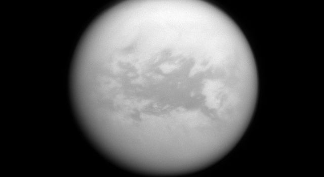 NASA's Cassini spacecraft peers down through the hazy atmosphere of Saturn's moon Titan to view the dark region called Belet. The large region called Belet has a low albedo, meaning it reflects little light.