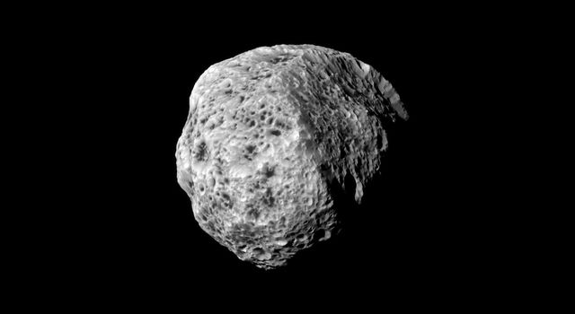 The sponge-like surface of Saturn's moon Hyperion is highlighted in this portrait from NASA's Cassini spacecraft, captured during the spacecraft's flyby on Sept. 16, 2011.
