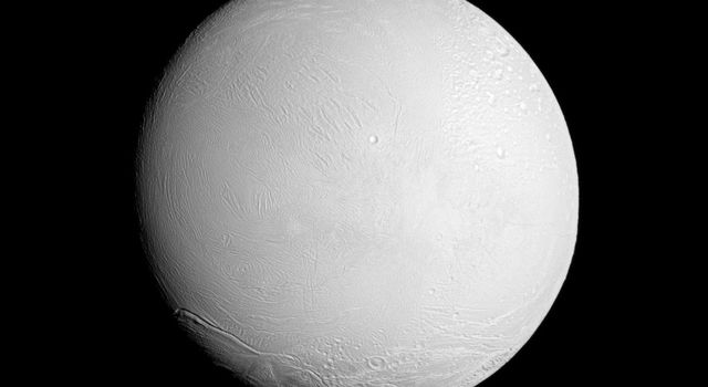 NASA's Cassini spacecraft looks at a brightly illuminated Enceladus and examines the surface of the leading hemisphere of this Saturnian moon.